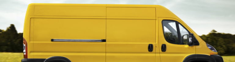 Courier moving freight in yellow van