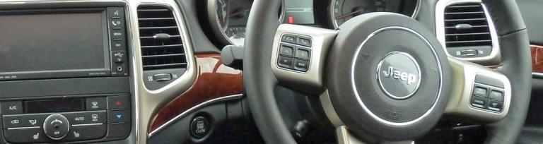 dashboard of a vehicle showing a drivers steering wheel